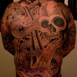 Tim Hendricks skull back tattoo picture