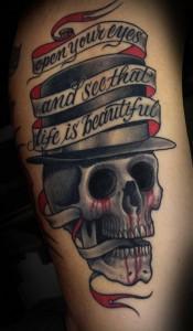 Tim Hendricks skull hat tattoo picture
